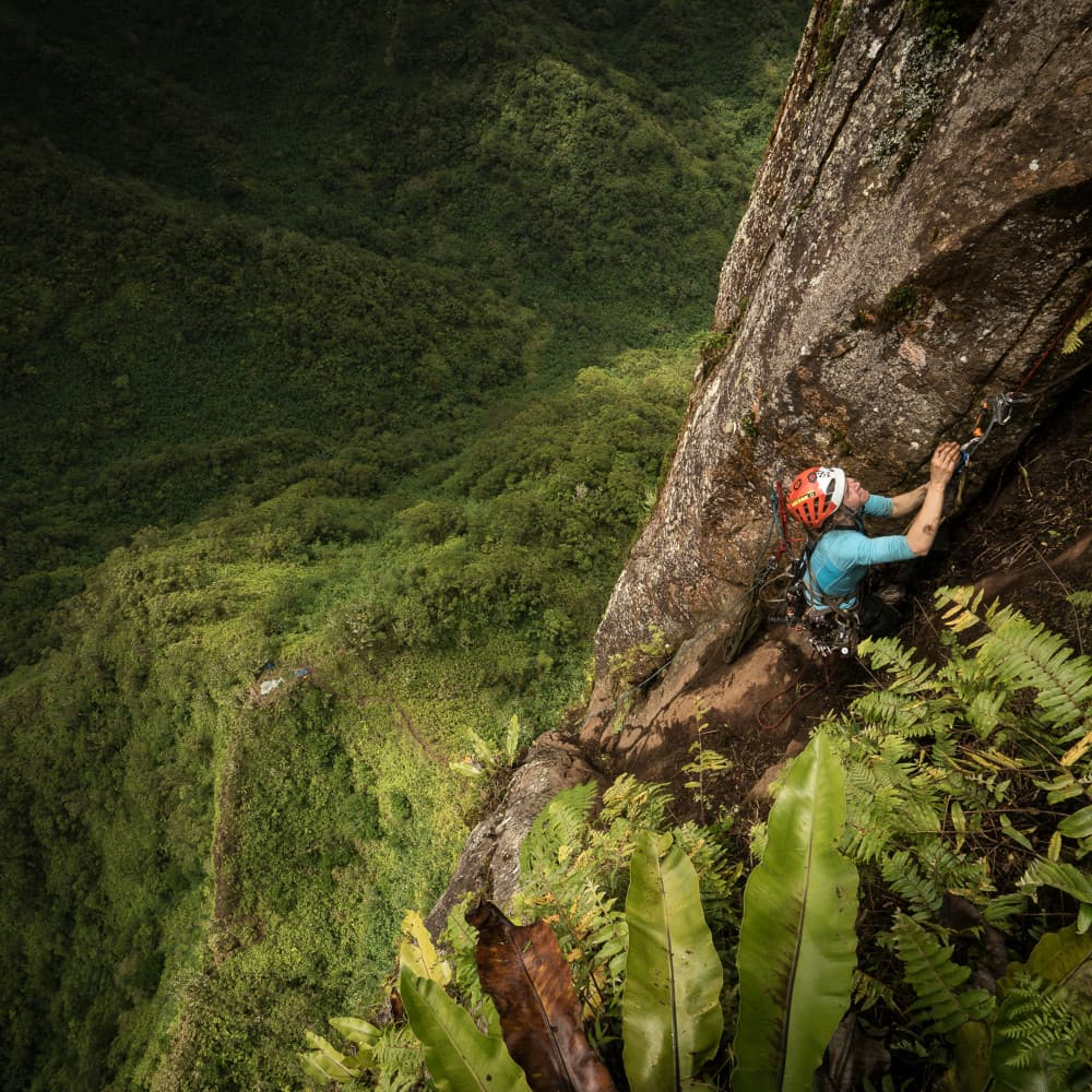 A photo of a person scaling a cliffside. Artist credit to Keith Ladzinski
